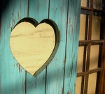 Cutout heart in wooden door