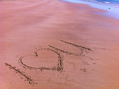 I love you in sand at beach